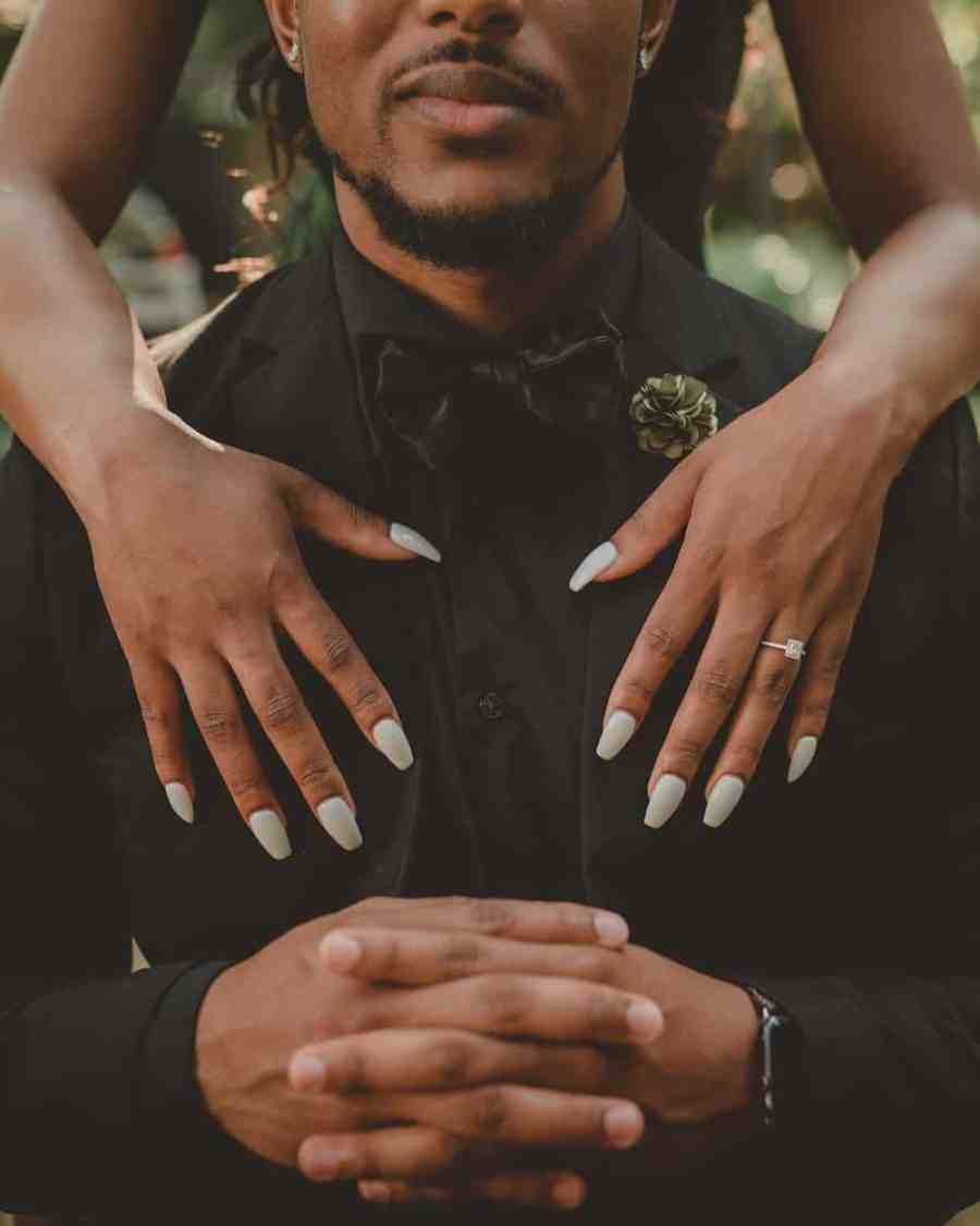Man and woman showing off their nails