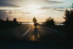 Man driving a Motorcycle into the sunset