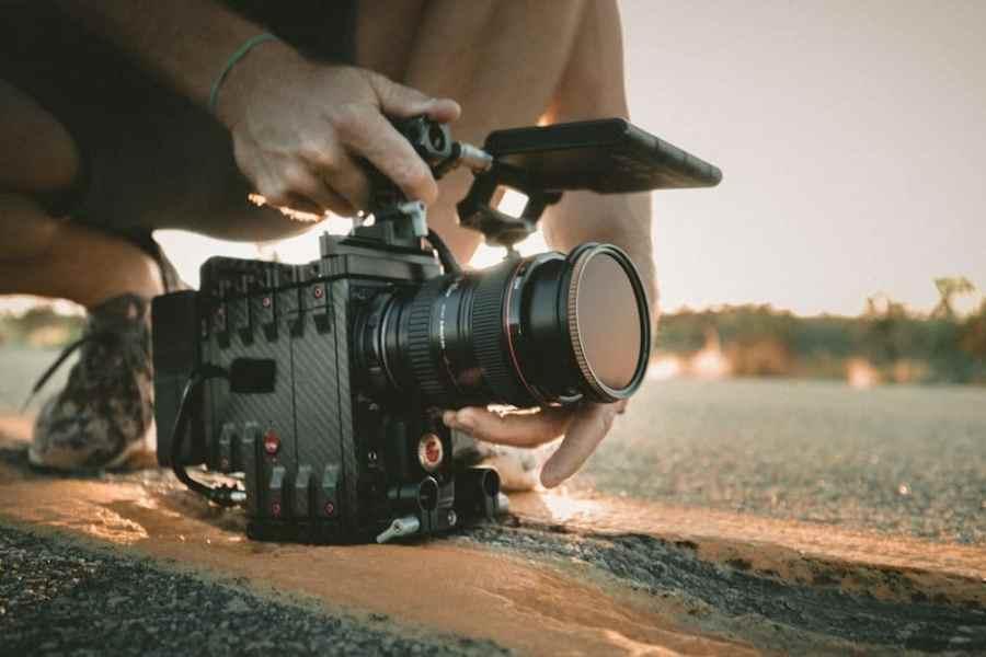 person using professional video camera