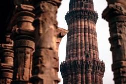 The Amazing Qutub Minar Seen Through the Pillars of a Jain Temple