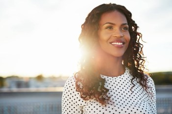 Happy Confident Woman Standing During sunset