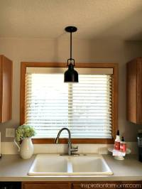 pendant light over kitchen sink updating the kitchen with ...