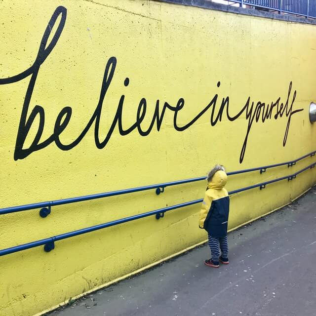 quotes-believing-yourself-yellow-wall-boy-reading