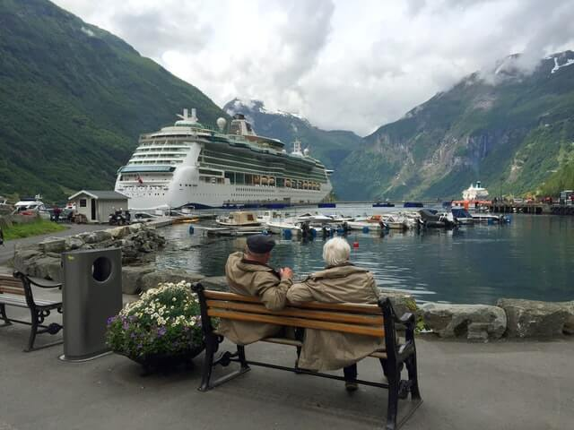 5-things-wish-knew-retirement-couple-bench-ship-mountains-water