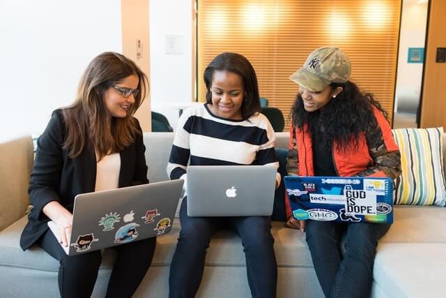 mastermind-definition-power-three-women-laptops-couch