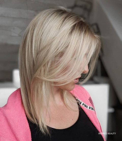 Blonde Medium Length Layered haircut