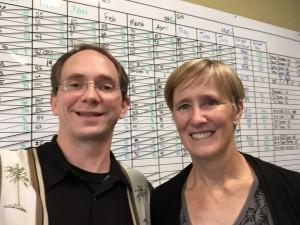 Maggie Bayless and Todd A Reed in front of ZingTrain's Big Board