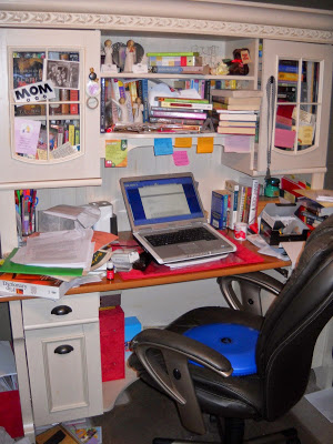 A sign over Cara's desk declares the most cherished of her many titles: MOM!