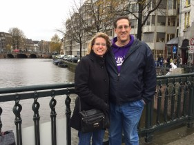 The canals of Amsterdam. My husband Wes with me on the windy bridge. We took a canal cruise and saw the old town with buildings dating back to the 1600s.