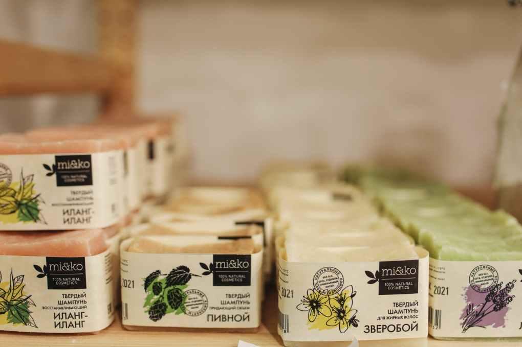 labeled bar soaps organized on shelf
