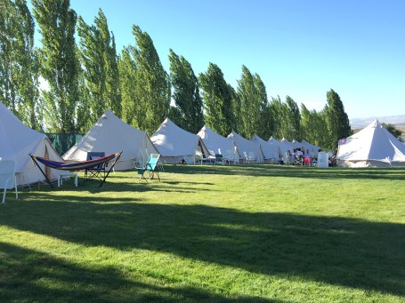 Row of canvas tents at The Gorge Oasis Campground