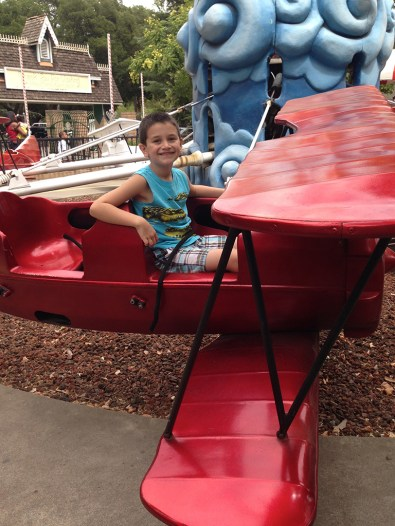 Carter Riding the Red Baron Airplane Ride at Funderland