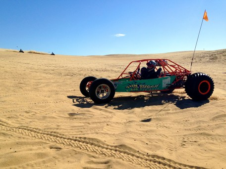 Brian and Natalie Bourn driving a Dune Buggy on the Sand Dunes at Pismo Beach