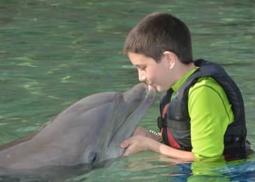 Carter Bourn Kissing a Dolphin