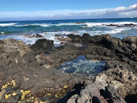 Holoholokai Beach Park is a Black Lava Rock and White Coral Rubble Beach