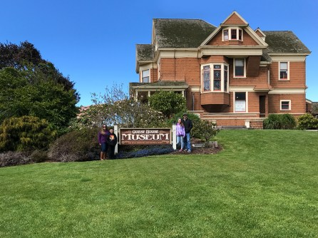 Bourn Family Standing Outside The Guest House Museum In Fort Bragg