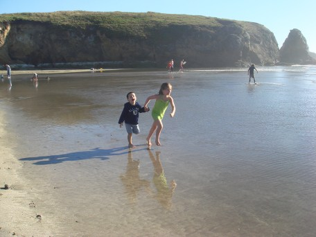 Kids Playing in the shallow water at Pudding Creek Beach