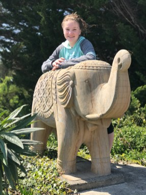 Natalie Bourn And Elephant Statues at a Yoga Studio in Point Arena