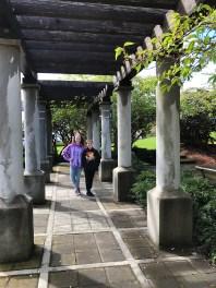 Natalie and Carter Bourn Walking Main Street In Fort Bragg