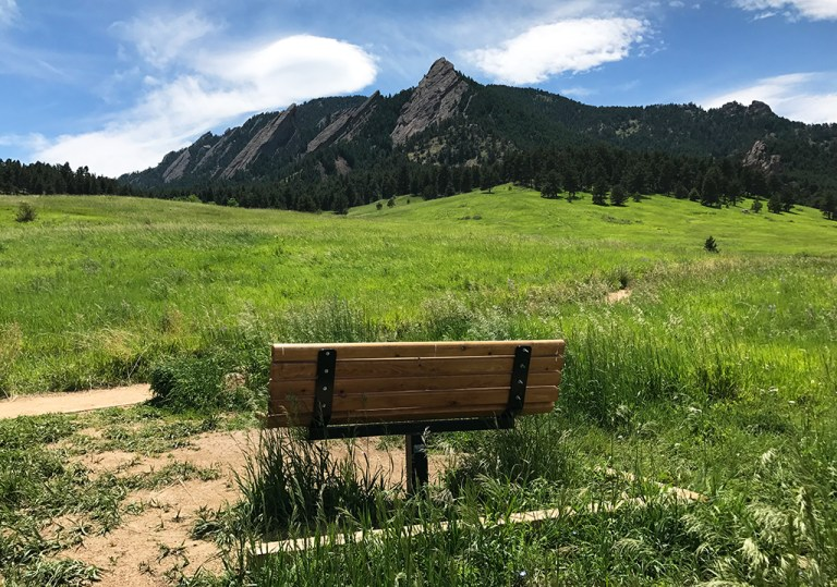 Bench in Chautauqua Park in Boulder with a View of The Flat Irons