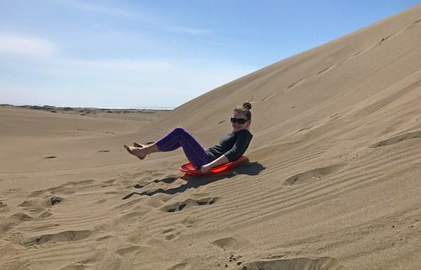 Natalie Bourn Sand Sledding at Ten Mile Dunes