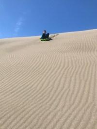 Sand Sledding At Ten Mile Dunes Near Fort Bragg, California
