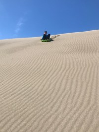 Sand Sledding At Ten Mile Dunes Near Fort Bragg, California