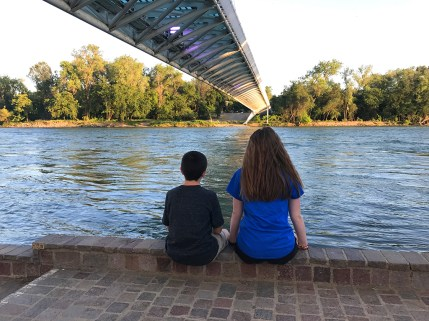 Natalie and Carter Bourn sitting under the Sundial Bridge