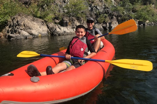 Carter and Brian Bourn Kayaking on the Smith River