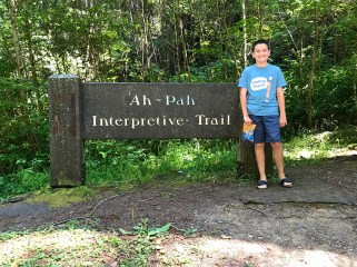 Carter Bourn standing at the Ah Pah Interpretive Trail Sign