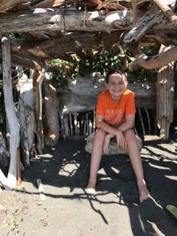 Carter Bourn in a Diftwood Fort at False Klamath Cove Beach