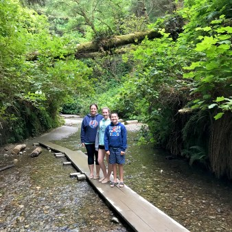 Jennifer, Natalie, and Carter hiking Fern Canyon
