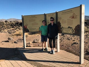 Carter and Natalie Bourn at the Fossil Falls Interpretive Display