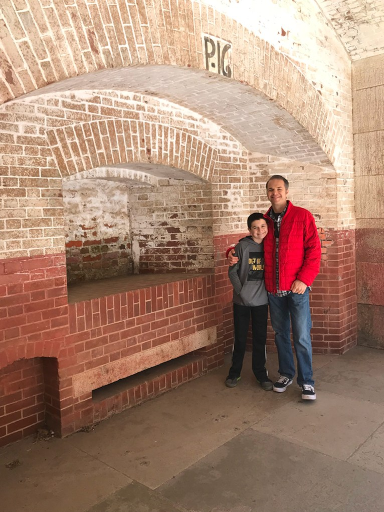 Carter and Brian Bourn Standing In A Cannon Stall at Fort Point