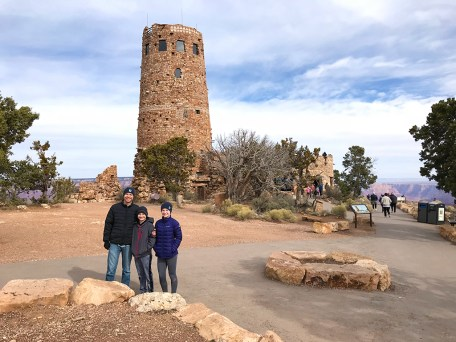 Brian, Carter, and Natalie Bourn in front of the Desert View Watchtower