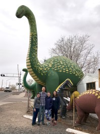 Bourn Family Posing With Dinosaurs at the Rainbow Rock Shop