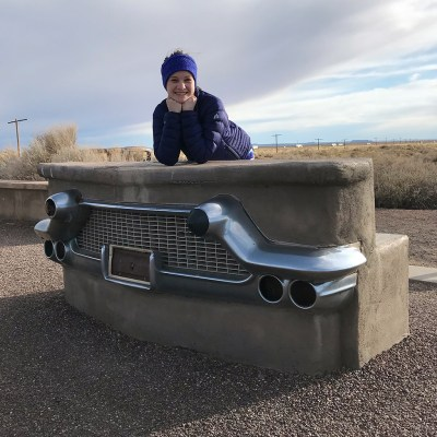 Natalie Bourn at the Route 66 Monument at Petrified Forest National Park