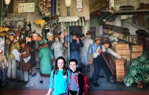 Natalie and Carter Bourn in front of the Coit Tower Murals