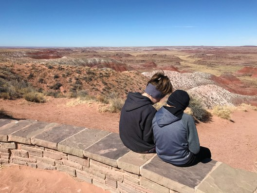 Natalie and Carter Bourn at Nizhoni Point in the Painted Desert