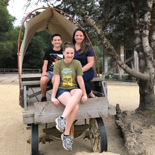 Jennifer, Natalie, and Carter Bourn Sitting in a Covered Wagon at Roaring Camp