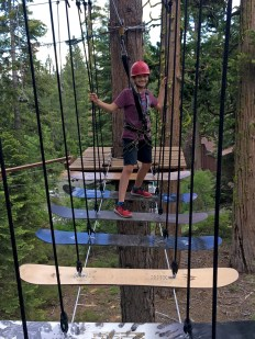 Walking Across Snowboards On The Lake Tahoe Ropes Course