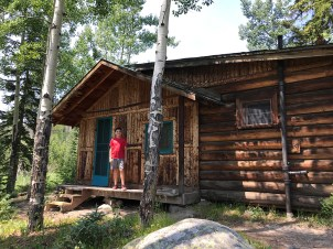 Carter Bourn exploring the cabins at the Holzwarth Dude Ranch