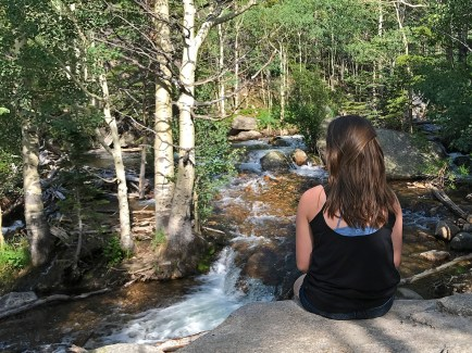 Natalie Bourn Sitting On Rocks Along Glacier Creek