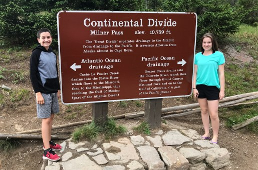 Natalie and Carter Bourn Standing On Continental Divide At Rocky Mountain National Park