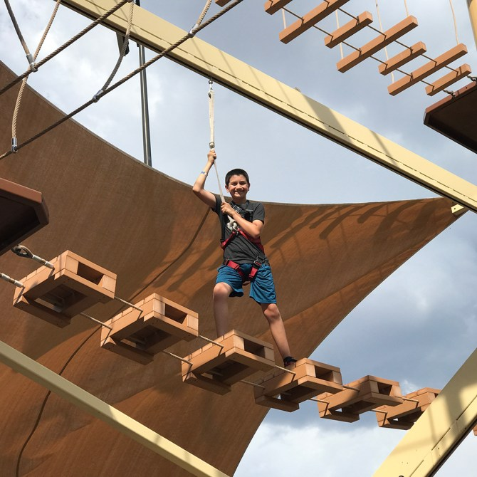 Carter Bourn Completing A Ropes Course