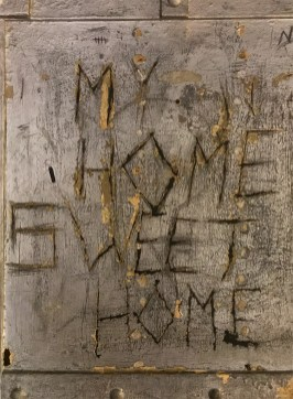 Message SCratched Into A Jail Cell Wall