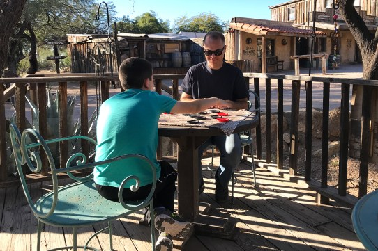 Brian and Carter Playing Checkers at Old Tucson Studios