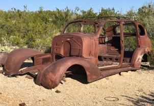 Rusty Old Car Sitting Among Cactus