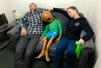 Brian and Natalie Bourn Napping With An Alien at the Area 51 Museum