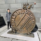 Carter Bourn Standing Next to a Giant Penny Sculpture at the SF MOMA